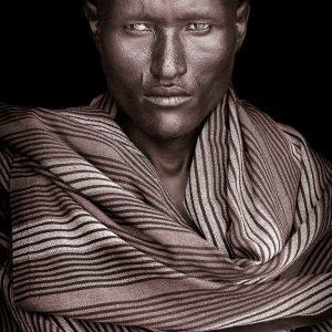 Acuan. A portrait photograph by John Kenny of a Turkana man from Kenya