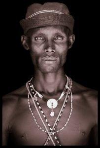 Ltailson. A portrait photograph by John Kenny of a Samburu man from Kenya